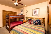 Second BR has a queen size bed, rustic and solid pine bunk beds, large closet and Flatscreen TV with HDMI cable so you can watch your own movies