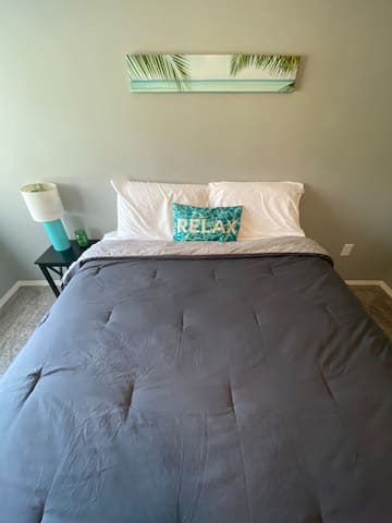 The Beach Room. Bedroom #4 with a queen bed located in the lower level.
