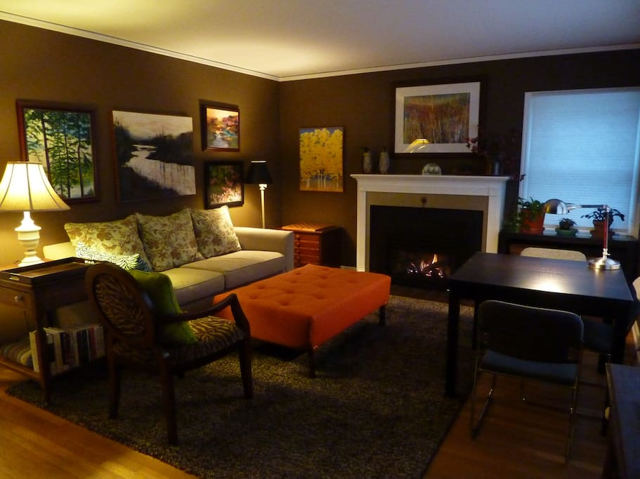 Living room with gas fireplace.  Lots of art, and good lighting.