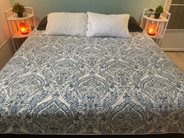 """BEDROOM #1 Brand NEW King size quality orthopedic bed, dresser and large closet with mirrors, 43"""" Roku rotating smart TV, A/C, ceiling fan + WIFI."""