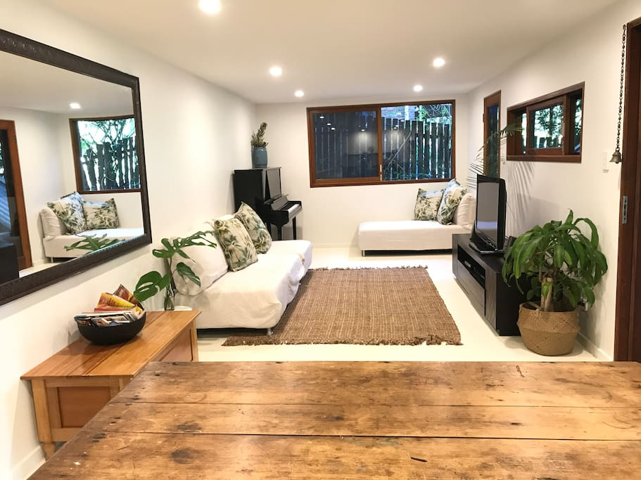 The super comfy and functional living space, as seen from the open plan kitchen.