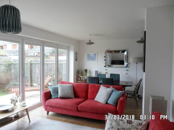 Private room in modern, refurbished coastal home