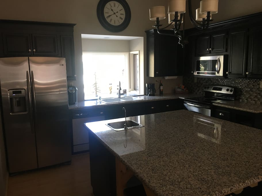 Stainless steel appliances and large kitchen