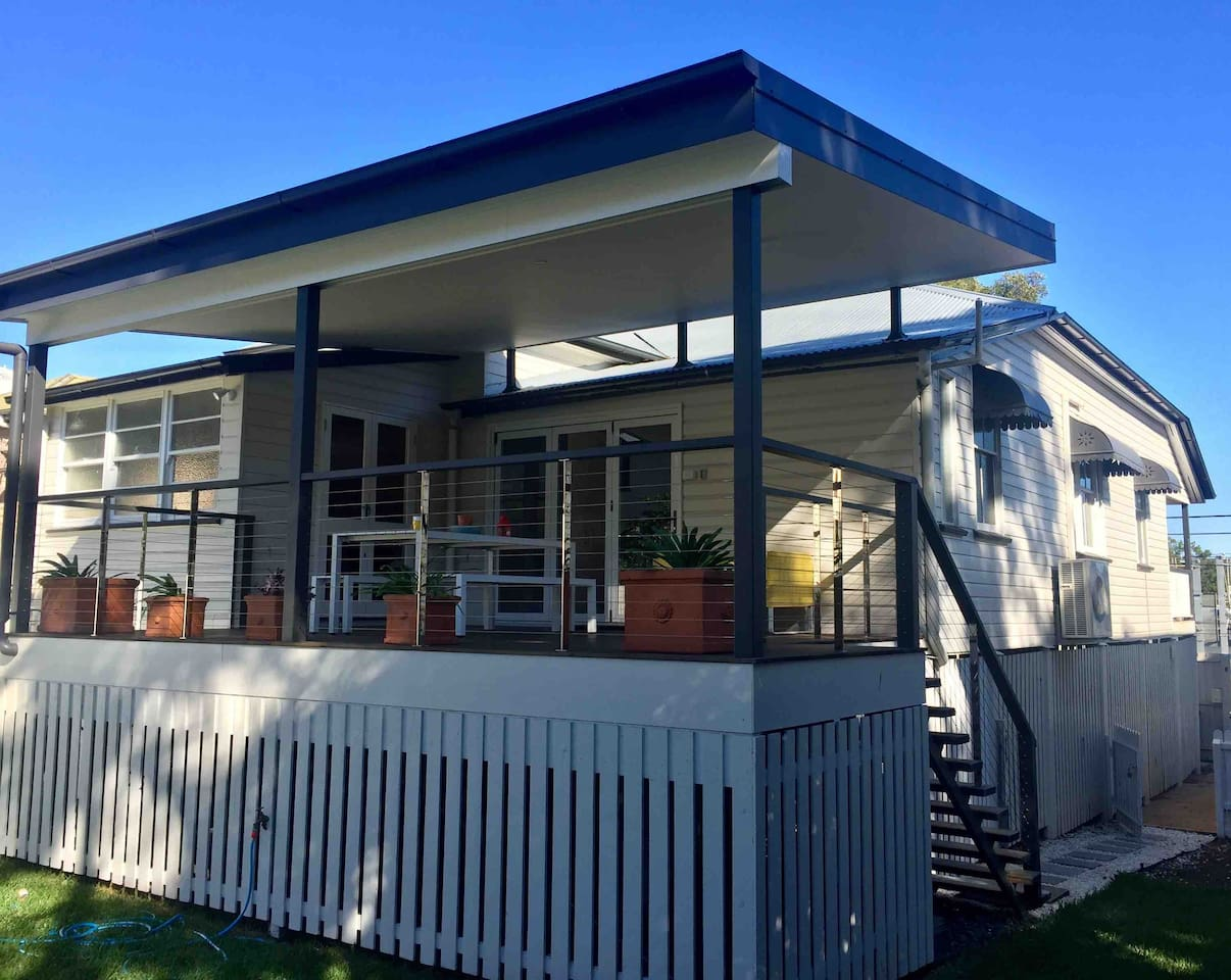 Our recently renovated Queenslander house with three bedrooms (sleeps up to six), new kitchen, comfortable lounge room, handy kids play space, new bathroom (and extra toilet room) and a spacious back deck. Perfect for all groups of guests!