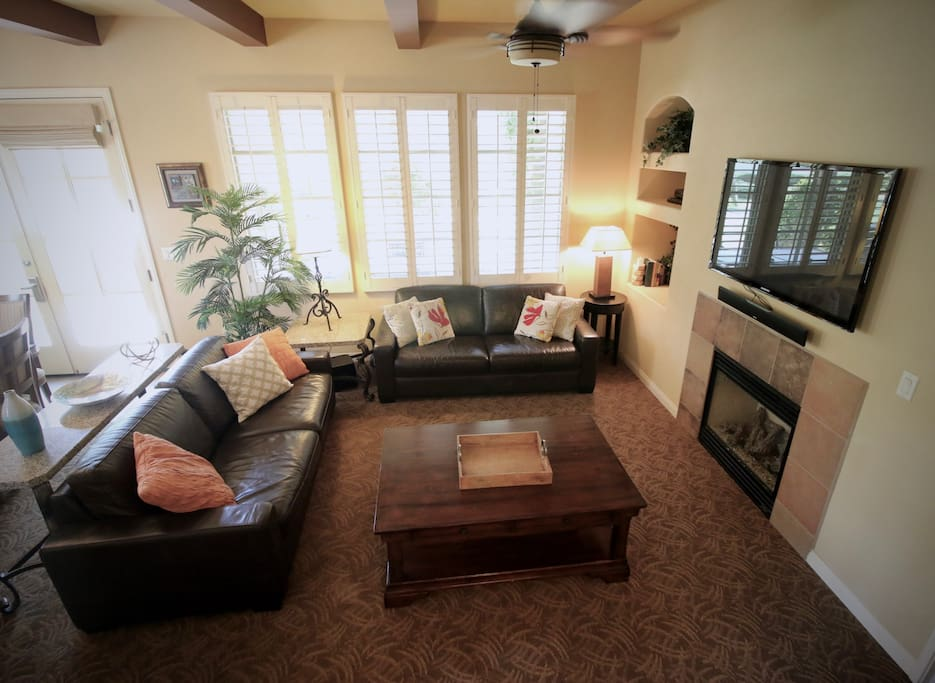 """Living Room with 51"""" TV, Full Sleeper, & oversized coffee table for board games."""