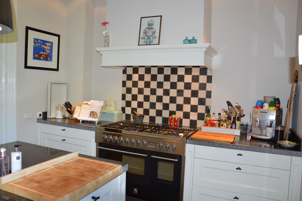 The luxurious kitchen has a double oven and eight gas burners to cook.