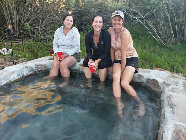 enjoying a soak in our custom rock hot tub.