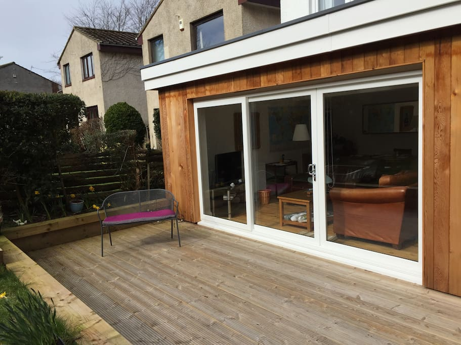 Lovely outdoor seating area for those sunny days.
