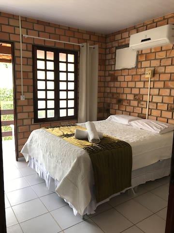 Quarto da suite com split e cortina
