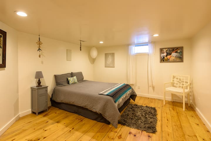 Bedroom #5 is a quiet and tucked away room in the renovated basement-level suite. Queen size bed.