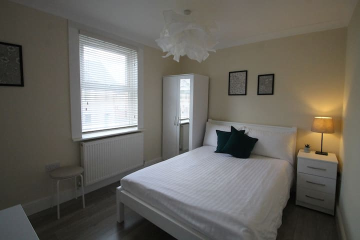 Clean double bedroom with a very comfortable bed.