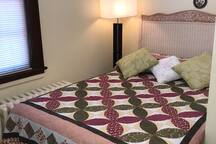 Second floor bedroom with double bed sleeps 2 people.  wood flooring and beautiful Victorian style arches.