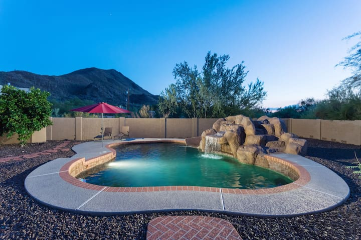 Beautiful Sparkling Pool w/ Rock Feature Waterfall and Custom Water Slide Sits Next to Saguaro Surrounded Mountain Views.