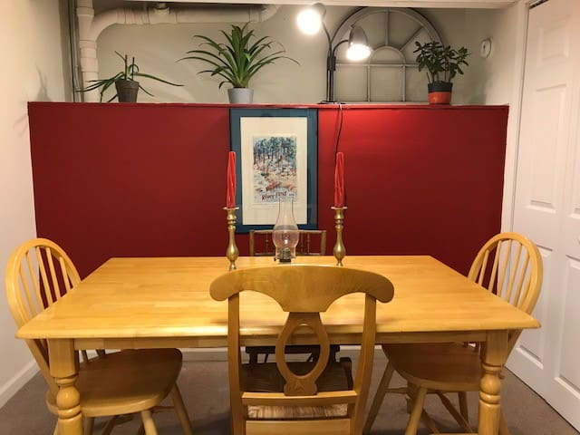 Dining setting.  Great table for a meal or game playing or puzzle building, etc.