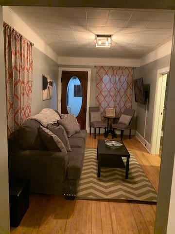 Warm and inviting living room with new furniture and Smart TV with Hulu & Netflix