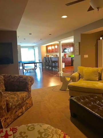 Airbnb includes bedroom with queen bed and attached private bathroom, bar area, living area with flat screen TV, full sized bed with single trundle bed. The entire area is for your private use during your stay.