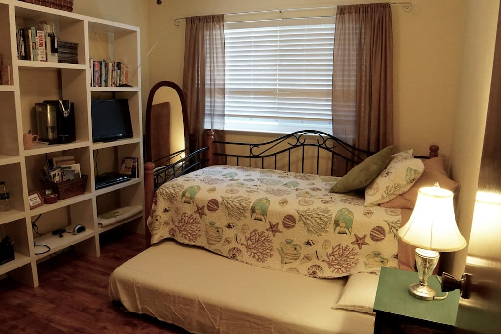 Room with trundle slide out bed