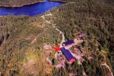Cabina superior amb quilòmetres d'amplada amb vista al bosc i al llac