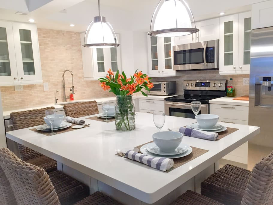 Fully-equipped, brand new kitchen seats six at huge island