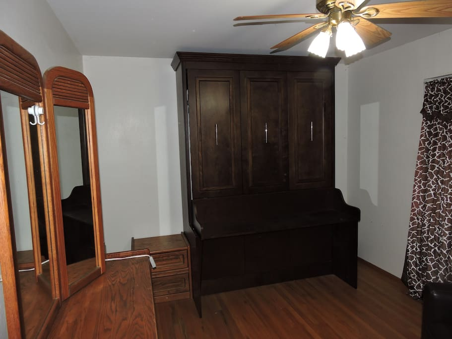 Murphy bed closed is a desk.