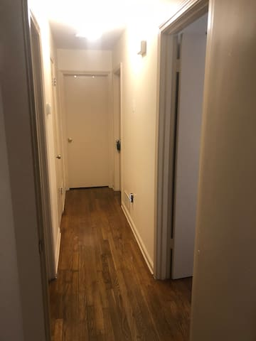 Hallway, room first door to the right.