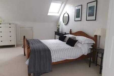 A large double room with private ensuite bathroom