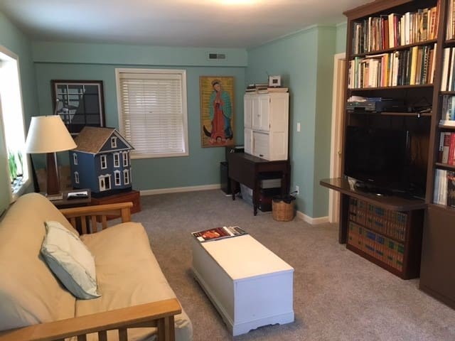 sitting area with futon for extra guests with tv, mini-refrigerator + microwave