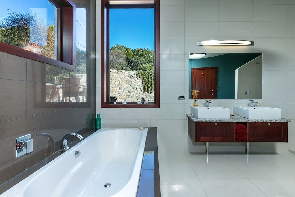 Master bathroom with two person bath and shower