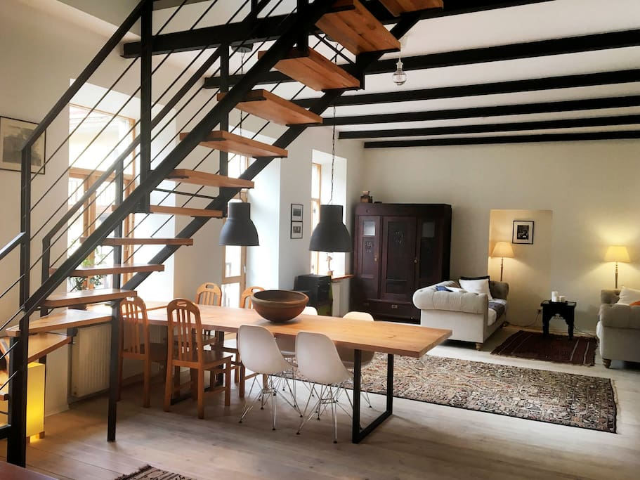 One spacious room with an open kitchen, dining and relax area. The staircase like the rest of the apartment was specially design by a renown Lithuanian architect.