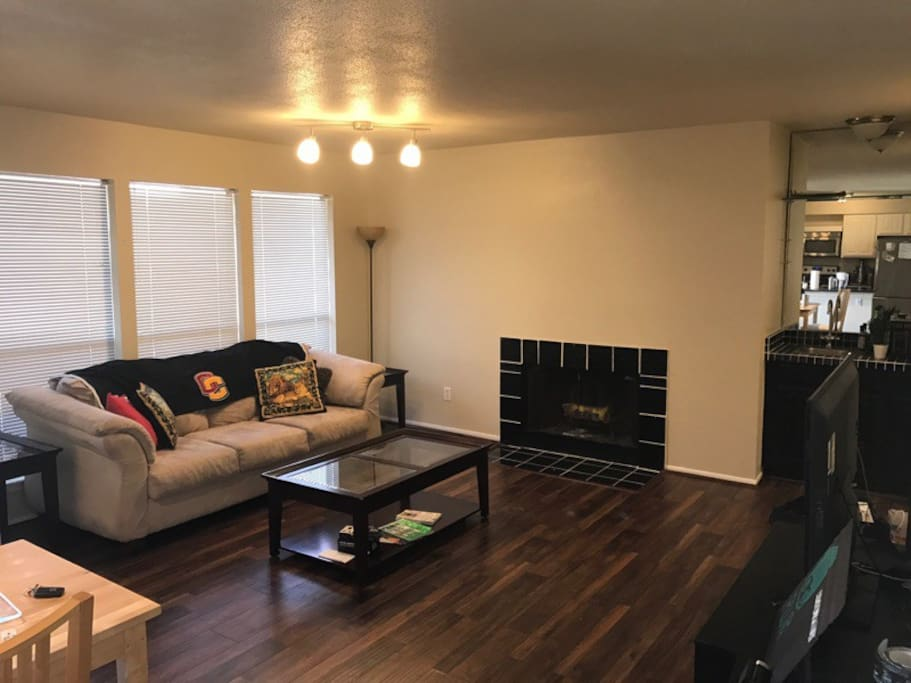 Plenty of space in the living area, with a fireplace and a flat screen TV