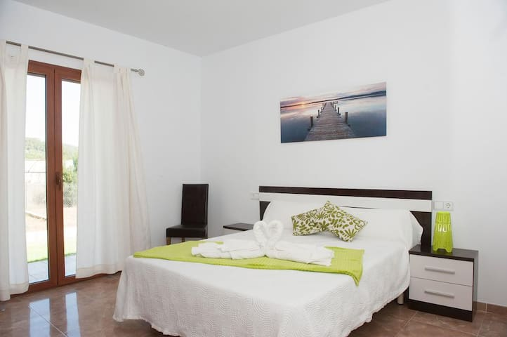Spacious bedroom with double bed and garden views