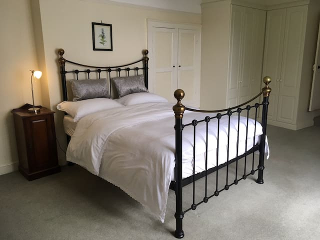 Spacious bedroom with en suite in period property