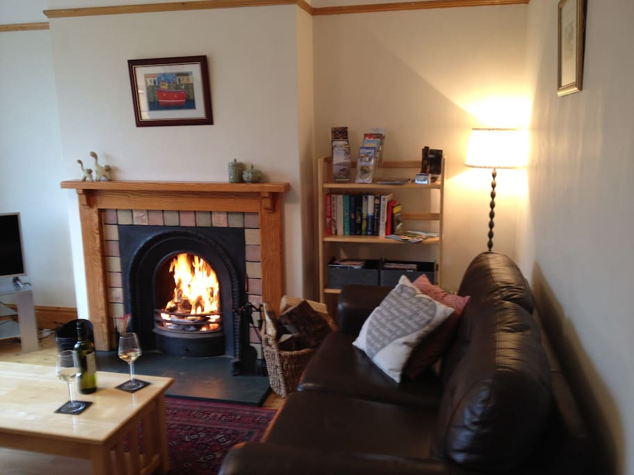 Sitting room and roaring log fire