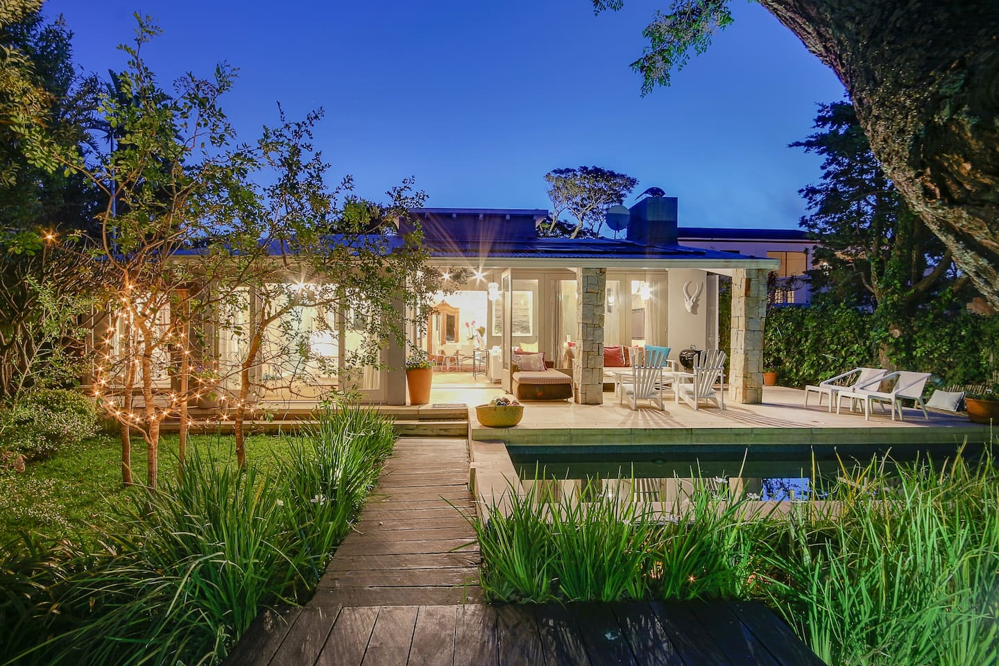 Welcome home to serene Shell Cottage, set in the most beautiful garden a block from the beach