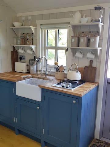 Custom Built Kitchen with Gas Hob, Mini-Fridge, Toaster and Microwave with Grill and Belfast Sink