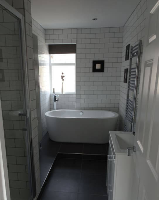 Our stunning bathroom with free standing bath and large shower.