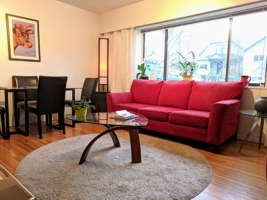 Spacious and bright living dining room. Comfy coach and arm chair.