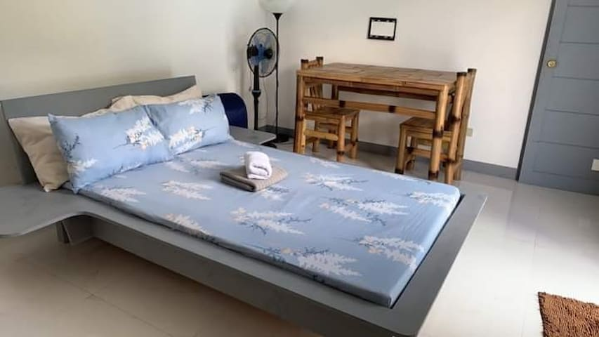 Bedroom 1 (w/ pool view)  *  with toilet and bath *  with AC *  uratex bed (2 pax)  *  available extra bed (2-4pax)  *  bamboo table with 2 chairs *  available elec fan  *  w/ access door to bedroom2 *  sliding glass door entance *  wifi & cable tv