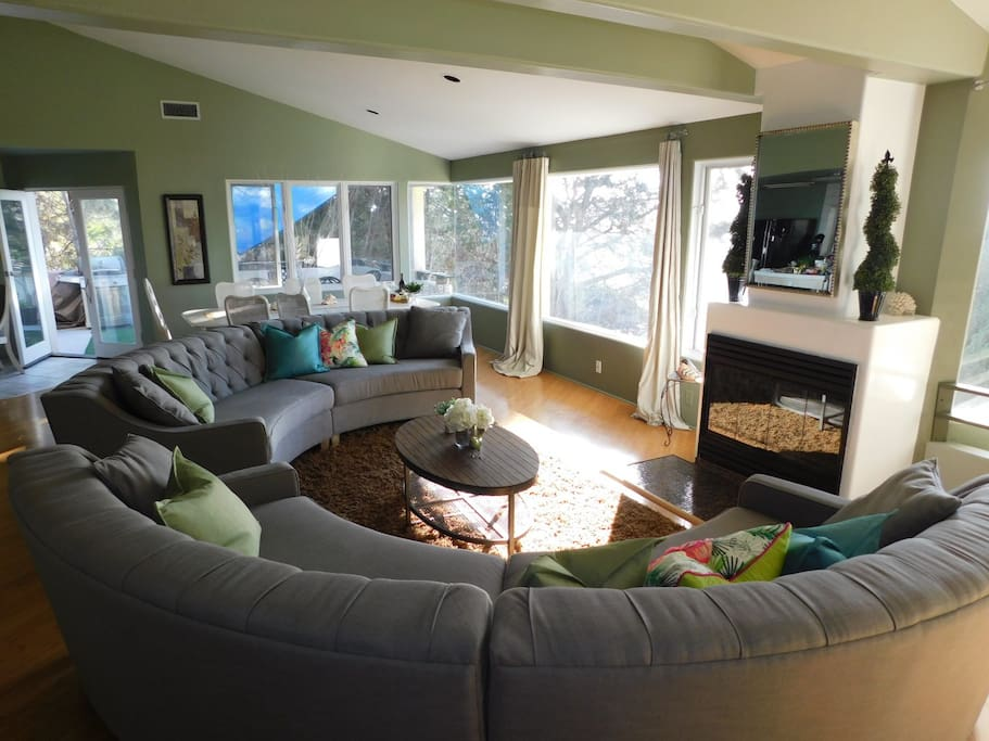Main living room with new couches makes a great cozy comfy conversation area!