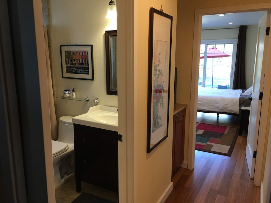 Attached private bath, with pocket door to separate from the rest of the house - mini fridge in hallway