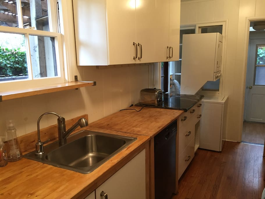 Kitchen Sink with Washer/Dryer at end of hall