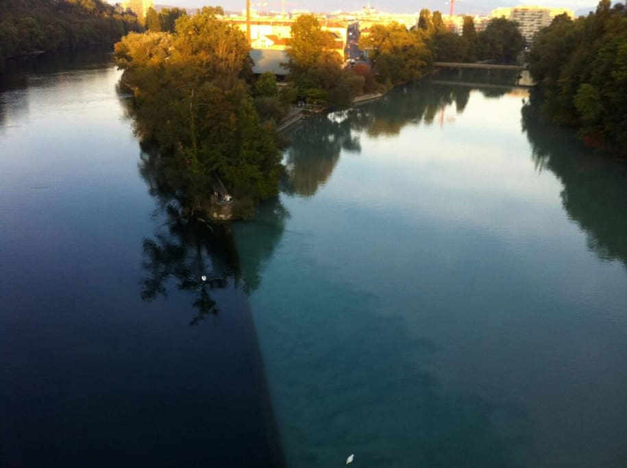 The river next to the flat is the Arve. About 15 minutes walk away the Arve joins another river called the Rhone, and the 2 rivers have different colors, creating this nice effect.