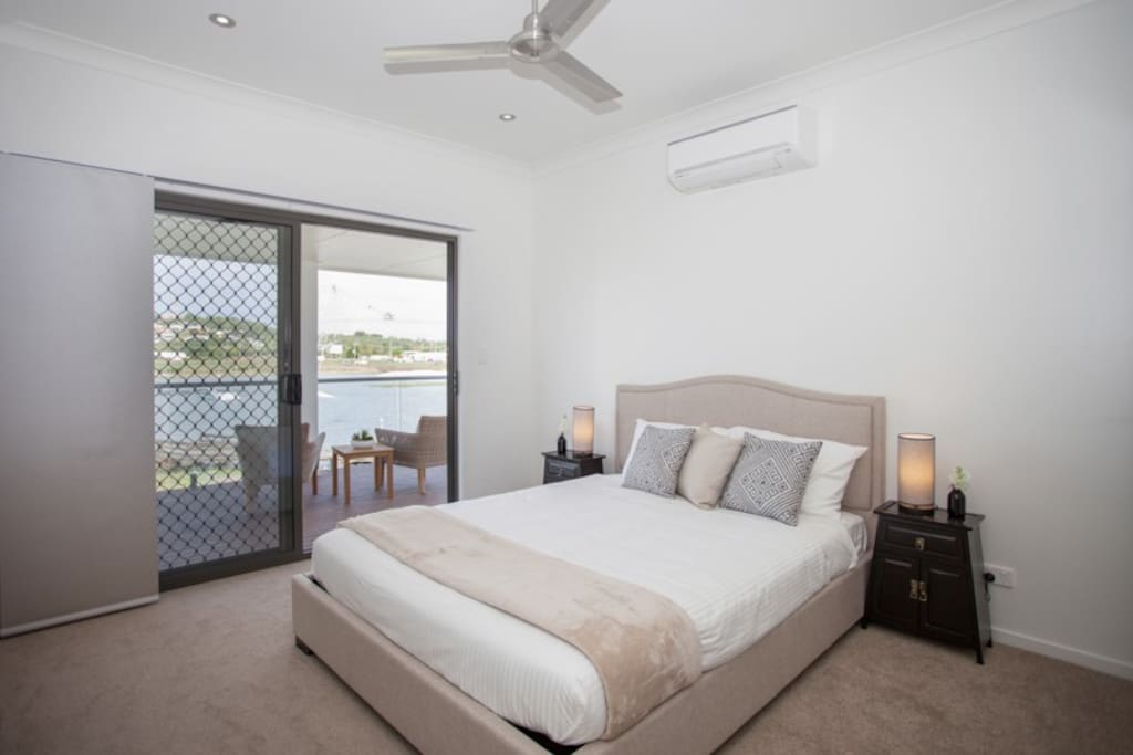 Master bedroom with ensuite and private balcony overlooking the lake
