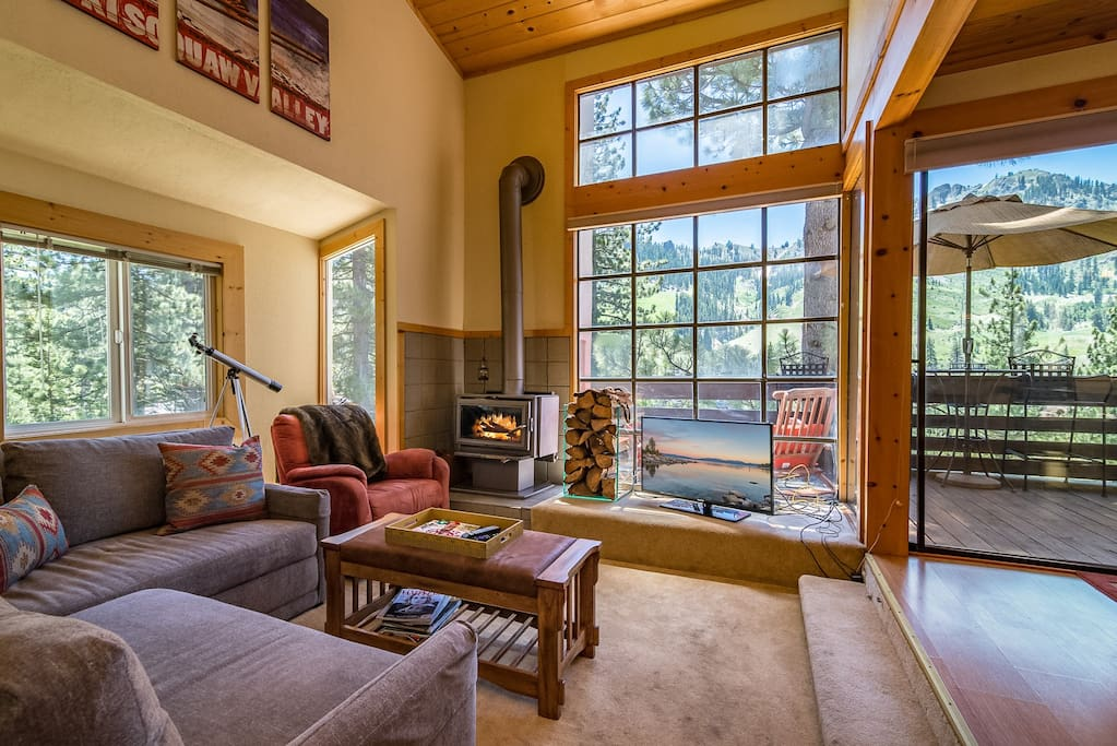 Large windows fill the living room with natural light.