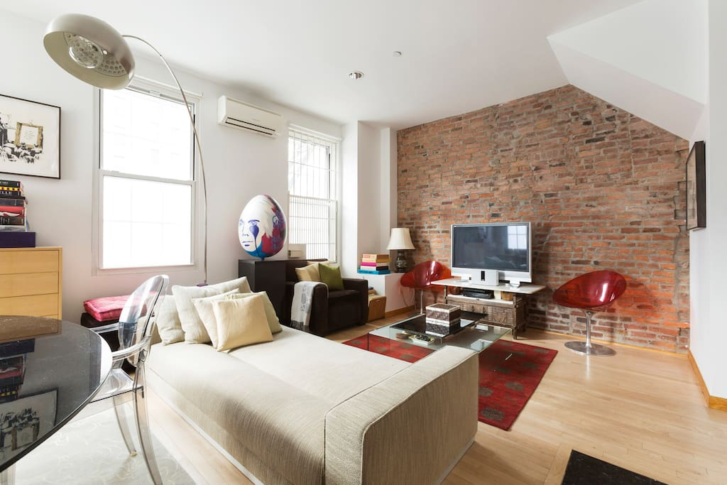 Large Living Area with exposed Brick - TV with FULL CABLE, & DVD - BOSE bluetooth sound dock