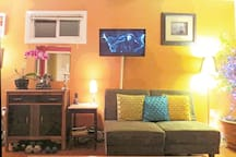 Vintage furniture and flat screen TV in the cozy, bright livingroom.