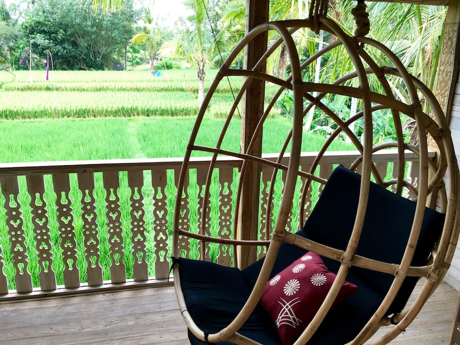 Relax in the hanging chair and take in the green fields