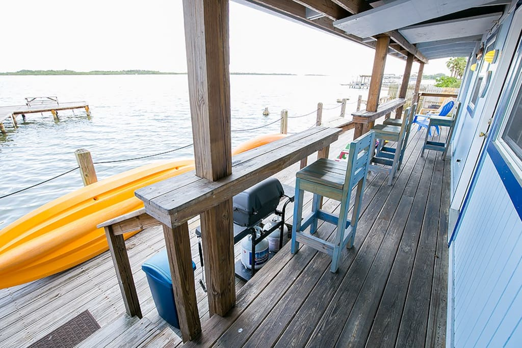 Covered water front porch with bar stools