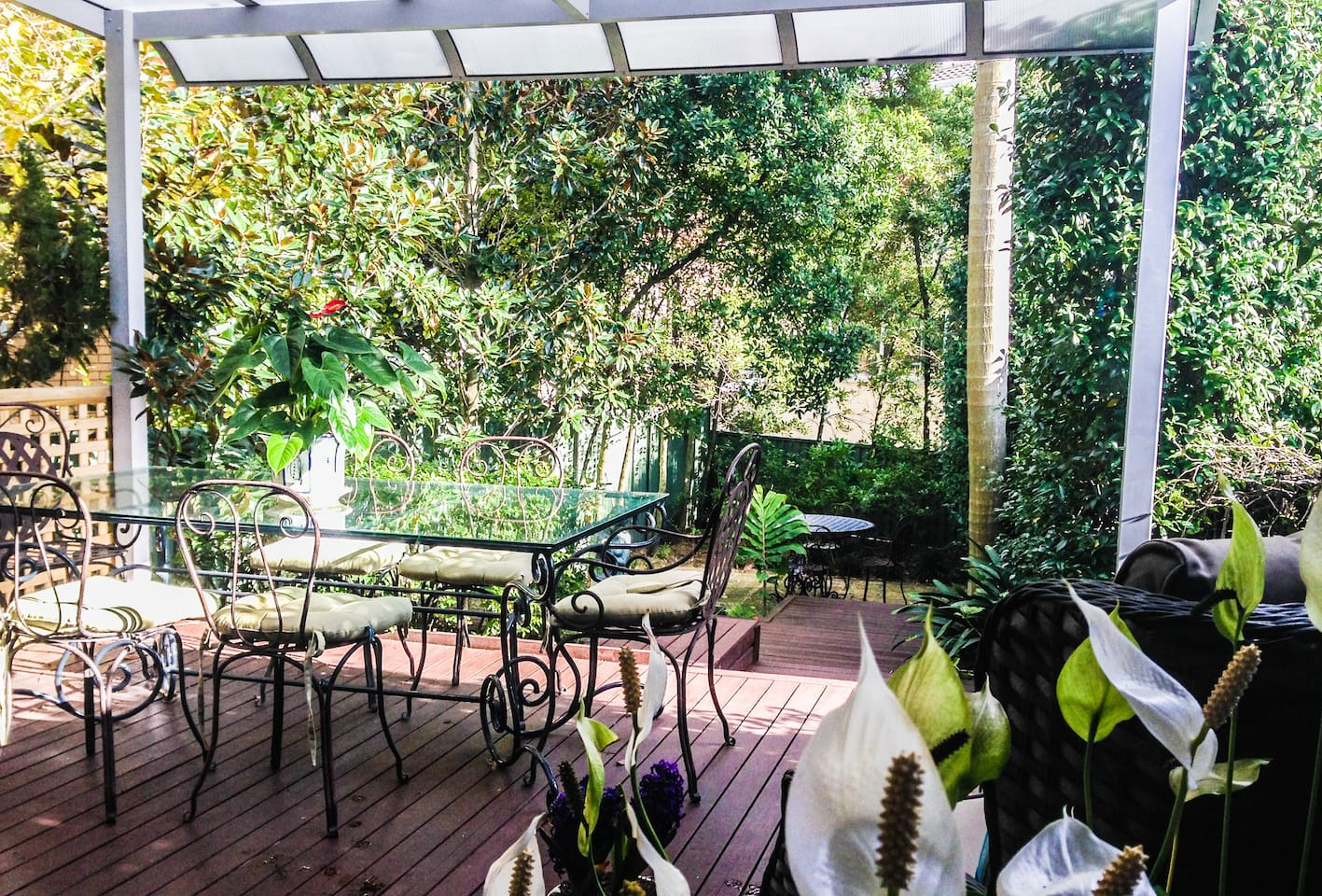 Private back garden with covered deck