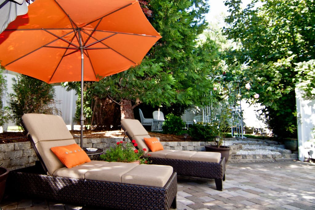 The perfect getaway... chaise lounges, patio seating, a firepit, and a secret garden!